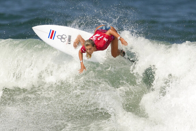 Costa Rica's Leilani McGonagle maneuvers on a wave during the second round of the women's surfing at the 2020 Summer Olympics, Sunday, July 25, 2021, at Tsurigasaki beach in Ichinomiya, Japan. (AP Photo/Francisco Seco)