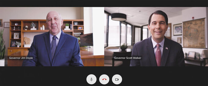 In this screen grab from video, former Wisconsin governors Jim Doyle and Scott Walker are joining together to call for people to get the COVID-19 vaccine in a new public service television advertisement. The spot released Thursday, June 10, 2021, produced by UW Health, features the Republican Walker placing a Zoom call to Doyle, a Democrat. Both are in their personal offices and never appear in the same room together.(UW Health via AP)