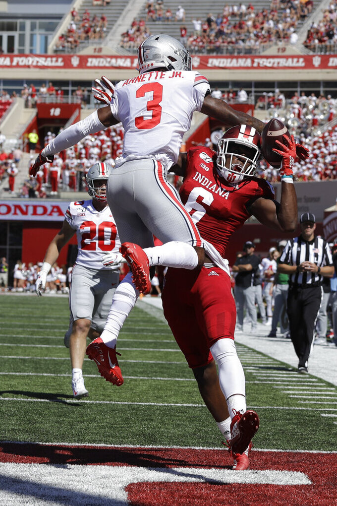 Ohio State cornerback Damon Arnette (3) breaks up a pass intended for Indiana wide receiver Donavan Hale (6) during the first half of an NCAA college football game, Saturday, Sept. 14, 2019, in Bloomington, Ind. (AP Photo/Darron Cummings)