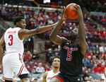 Rutgers forward Eugene Omoruyi, right, goes up for a shot against Ohio State guard C.J. Jackson during the first half of an NCAA college basketball game in Columbus, Ohio, Saturday, Feb. 2, 2019. (AP Photo/Paul Vernon)
