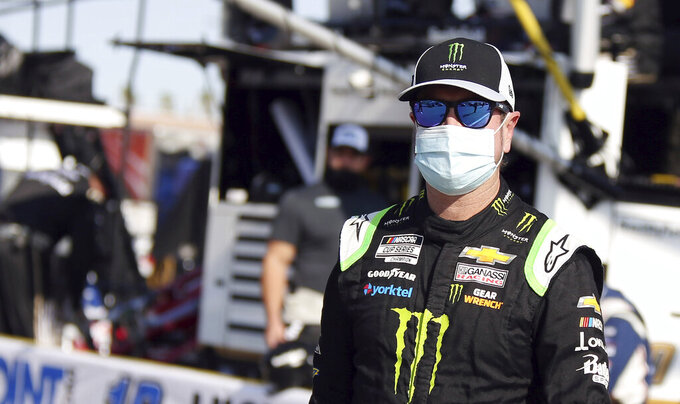 Kurt Busch walks to his race car before a NASCAR Cup Series auto race Sunday, Sept. 27, 2020, in Las Vegas. (AP Photo/Isaac Brekken)