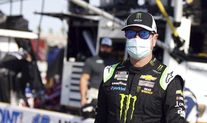 Kurt Busch walks to his race car before a NASCAR Cup Series auto race Sunday, Sept. 27, 2020, in Las Vegas. (AP Photo/Isaac Brekken)