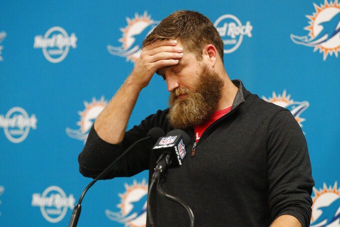FILE - In this Nov. 17, 2019, file photo, Miami Dolphins quarterback Ryan Fitzpatrick (14) speaks during a post-game news conference, following an NFL football game in Miami Gardens, Fla. Dolphins coach Brian Flores promoted Tua Tagovailoa, and the Dolphins' top draft pick will make his first NFL start Sunday, Nov. 1, 2020, against the Los Angeles Rams. The timing of the change was surprising because the Dolphins (3-3) have won their past two games, and the 37-year-old Fitzpatrick said his demotion left him heartbroken.(AP Photo/Wilfredo Lee, File)