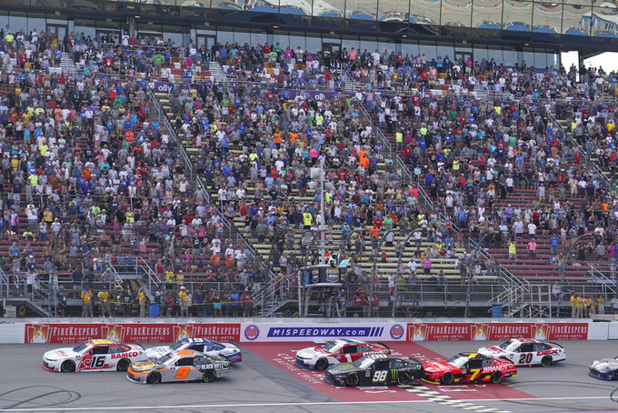A.J. Allmendinger (16) leads the field during the final overtime period at the NASCAR Xfinity Cup Series auto race at Michigan International Speedway, Saturday, Aug. 21, 2021, in Brooklyn, Mich. (AP Photo/Carlos Osorio)