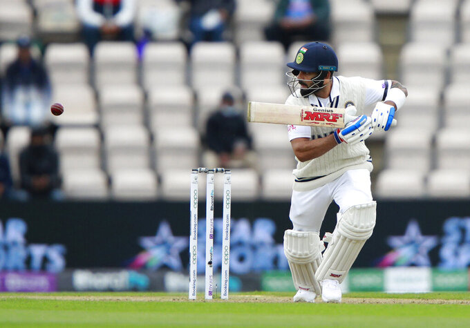 India's captain Virat Kohli bats during the second day of the World Test Championship final cricket match between New Zealand and India, at the Rose Bowl in Southampton, England, Saturday, June 19, 2021. (AP Photo/Ian Walton)