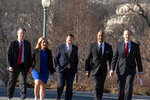 States Attorneys General, from left; Steve Marshall, Ala., Leslie Rutledge, Ark., Jeff Landry, La., Curtis Hill, Ind., and Alan Wilson, S.C., walk to a news conference where they announced that Republican Attorneys General of 21 states submitted a letter to reject the two articles of Impeachment against President Donald Trump, on Capitol Hill in Washington, Wednesday, Jan. 22, 2020. (AP Photo/Cliff Owen)