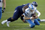 Detroit Lions quarterback Matthew Stafford is tackled by Tennessee Titans defensive tackle Teair Tart during the second half of an NFL football game Sunday, Dec. 20, 2020, in Nashville, N.C. (AP Photo/Ben Margot)
