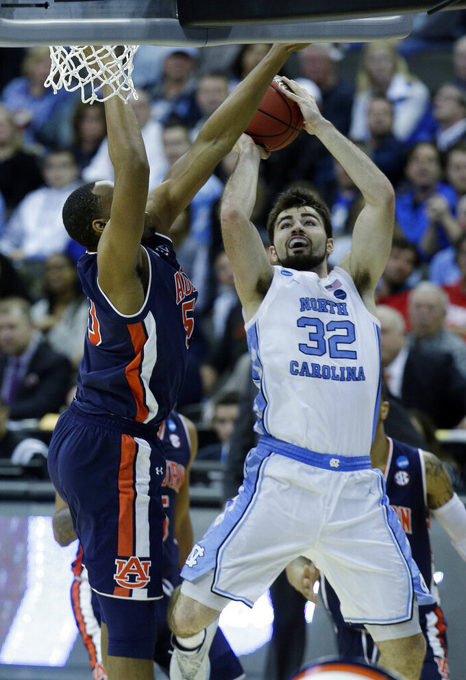 North Carolina's Luke Maye (32) shoots over Auburn's Austin Wiley during the first half of a men's NCAA tournament college basketball Midwest Regional semifinal game Friday, March 29, 2019, in Kansas City, Mo. (AP Photo/Charlie Riedel)