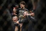 Henry Cejudo celebrates after a flyweight mixed martial arts championship bout against TJ Dillashaw at UFC Fight Night early Sunday, Jan. 20, 2019, in New York. Cejudo stopped Dillashaw in the first round. (AP Photo/Frank Franklin II)