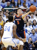 North Carolina's Kenny Williams (24) guards Virginia's Kyle Guy (5) during the second half of an NCAA college basketball game in Chapel Hill, N.C., Monday, Feb. 11, 2019. Virginia won 69-61. (AP Photo/Gerry Broome)