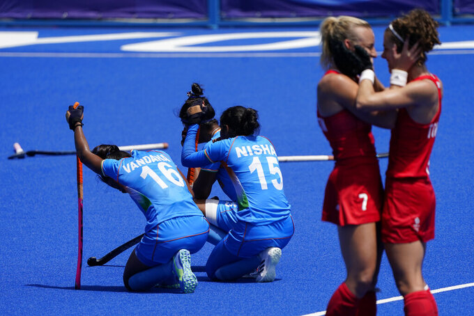India's Vandana Katariya (16) and India's Nisha (15) kneel on the field after losing their women's field hockey bronze medal match against Britain at the 2020 Summer Olympics in Tokyo. (AP Photo/John Minchillo, File)