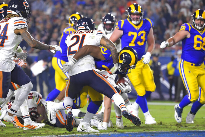 Los Angeles Rams running back Malcolm Brown scores past Chicago Bears strong safety Ha Ha Clinton-Dix during the second half of an NFL football game Sunday, Nov. 17, 2019, in Los Angeles. (AP Photo/Mark J. Terrill)