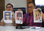 Indonesian National Police spokesperson Brig. Gen. Dedi Prasetyo, right, and an aide show photos of the suspects in the knife attack against Indonesian Coordinating Minister for Politics, Law and Security Wiranto Syahril Alamsyah, left, and his wife Fitri Andriana, along with the knives they used, during a press conference in Jakarta, Indonesia, Friday, Oct. 11, 2019. Alamsyah, who was suspected of belonging to a radical Islamic group wounded the top security minister, a local police chief and another person in an attack in western Indonesia on Thursday. (AP Photo/Tatan Syuflana)