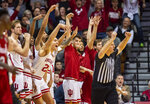 Players on the Indiana bench react as a teammate hits a three-point basket during the overtime period of an NCAA college basketball game against Nebraska, Friday, Dec. 13, 2019, in Bloomington, Ind. (AP Photo/Doug McSchooler)