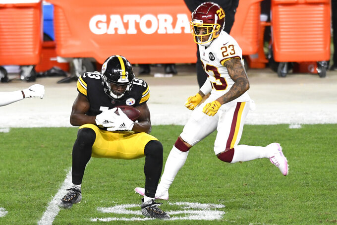 Pittsburgh Steelers wide receiver James Washington (13) makes a catch in front of Washington Football Team cornerback Ronald Darby (23) during the first half of an NFL football game in Pittsburgh, Monday, Dec. 7, 2020. (AP Photo/Barry Reeger)