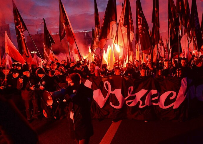 People take part in the March of Independence organized by far right activists to celebrate 101 years of Poland's independence, in Warsaw, Poland, Monday, Nov. 11, 2019. (AP Photo/Czarek Sokolowski)