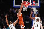 Texas forward Jericho Sims (20) dunks as California guard Matt Bradley (20) and California forward Grant Anticevich (15) watch from the floor during the first half of an NCAA college basketball game in the 2K Empire Classic, Friday, Nov. 22, 2019, in New York. (AP Photo/Kathy Willens)