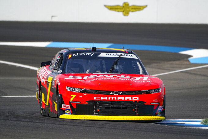 Justin Allgaier (7) drives through a turn during qualifying for the NASCAR Xfinity Series auto race at Indianapolis Motor Speedway in Indianapolis, Saturday, Aug. 14, 2021. (AP Photo/Michael Conroy)