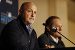 Washington Nationals general manager Mike Rizzo, left, listens to a question alongside agent Scott Boras, right, during the Major League Baseball winter meetings Monday, Dec. 9, 2019, in San Diego. Nationals pitcher and World Series MVP Stephen Strasburg agreed to a record $245 million, seven-year contract on Monday. (AP Photo/Gregory Bull)