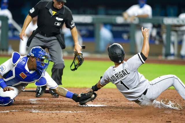Chicago White Sox's Nick Madrigal (1) is tagged out by Kansas City Royals catcher Salvador Perez as he tried to score on a single hit by Leury Garcia during the seventh inning of a baseball game Friday, July 31, 2020, in Kansas City, Mo. (AP Photo/Charlie Riedel)