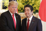 FILE - In this May 27, 2019, file photo, U.S. President Donald Trump, left, and Japanese Prime Minister Shinzo Abe pose for a photo prior to their meeting at Akasaka Palace, Japanese state guest house, in Tokyo. Japan's defense spending is expected to set a new record next year as the country strengthens its military alliance with the U.S. and buys expensive American weapons amid threats from China and North Korea. Under pressure from Trump, Japan has been buying costly military equipment as a way of reducing the U.S. trade deficit while bolstering defense cooperation. (AP Photo/Eugene Hoshiko, Pool, File)