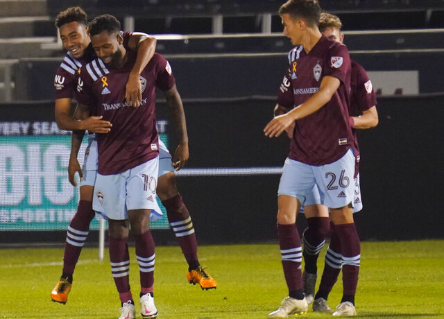 Colorado Rapids forward Jonathan Lewis, left, celebrates scoring a goal with midfielders Kellyn Acosta and Cole Bassett (26) during the second half of an MLS soccer match against the San Jose Earthquakes on Wednesday, Sept. 23, 2020, in Commerce City, Colo. The Rapids won 5-0. (AP Photo/David Zalubowski)