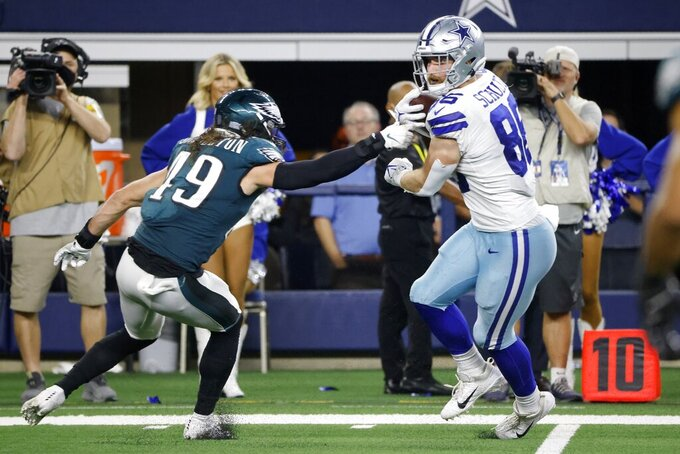 Philadelphia Eagles linebacker Alex Singleton (49) defends as Dallas Cowboys tight end Dalton Schultz (86) catches a pass he would run to the end zone for a touchdown in the second half of an NFL football game in Arlington, Texas, Monday, Sept. 27, 2021. (AP Photo/Michael Ainsworth)