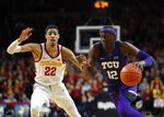 TCU forward Kouat Noi, right, drives past Iowa State guard Tyrese Haliburton, left, to the basket during the first half of an NCAA college basketball game, Saturday, Feb. 9, 2019, in Ames. (AP Photo/Matthew Putney)