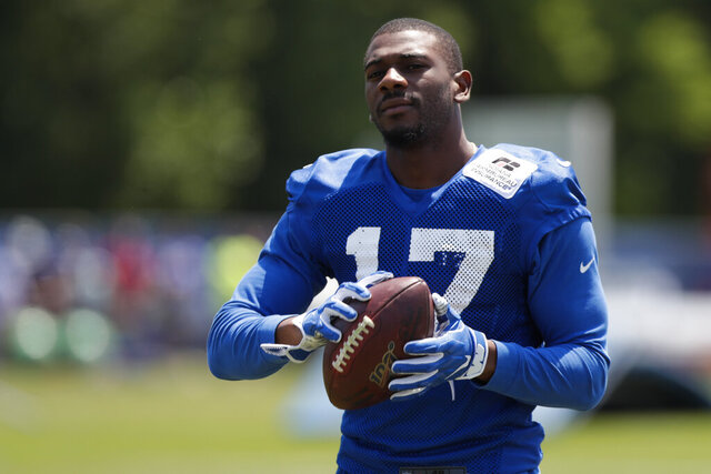 FILE - In this  Thursday, July 25, 2019 file photo, Indianapolis Colts wide receiver Devin Funchess (17) runs a drill during practice at the NFL team's football training camp in Westfield, Ind. The Green Bay Packers announced the signing of Funchess on April 2. Packers wide receiver Devin Funchess is opting out of playing this season in a move he calls one of the most difficult decisions he's ever made. Funchess' exit leaves Green Bay without its only major offseason addition to their receiving corps. (AP Photo/Michael Conroy, File)