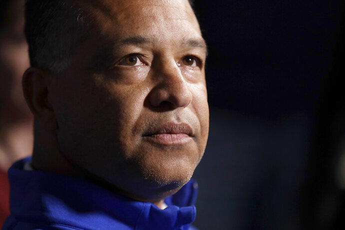FILE - This Dec. 2019 file photo shows Los Angeles Dodgers manager Dave Roberts during Major League Baseball winter meetings in San Diego. In what's become a familiar refrain, the Dodgers arrive at camp still looking for their first World Series championship since 1988. After losing in two straight World Series, they were ousted by Washington in five games in the NL Division Series last fall. (AP Photo/Gregory Bull, File)
