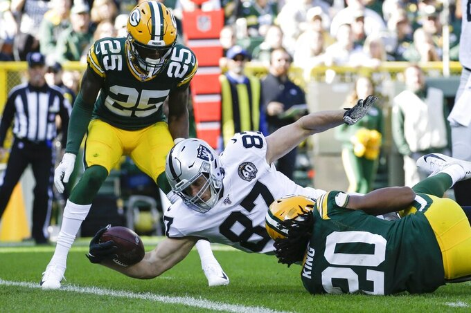 Oakland Raiders' Foster Moreau dives into the end zone for a touchdown catch during the first half of an NFL football game against the Green Bay Packers Sunday, Oct. 20, 2019, in Green Bay, Wis. (AP Photo/Jeffrey Phelps)