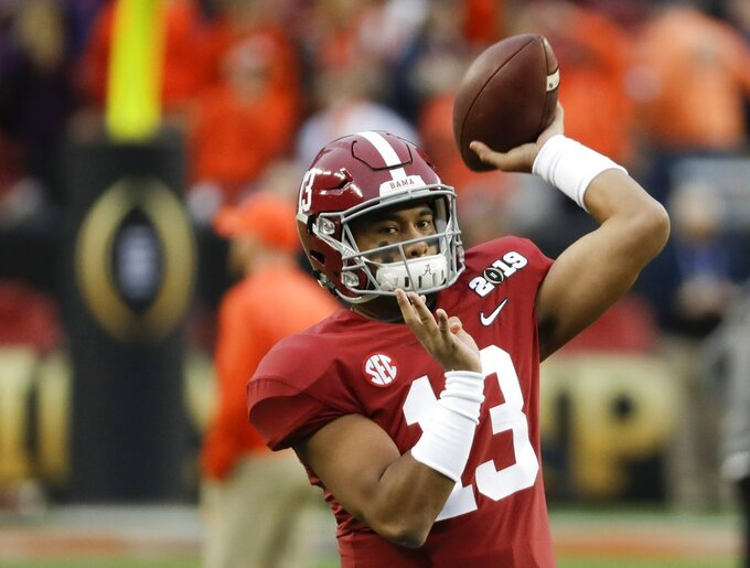 Alabama's Tua Tagovailoa warms up before the NCAA college football playoff championship game against Clemson Monday, Jan. 7, 2019, in Santa Clara, Calif. (AP Photo/Chris Carlson)