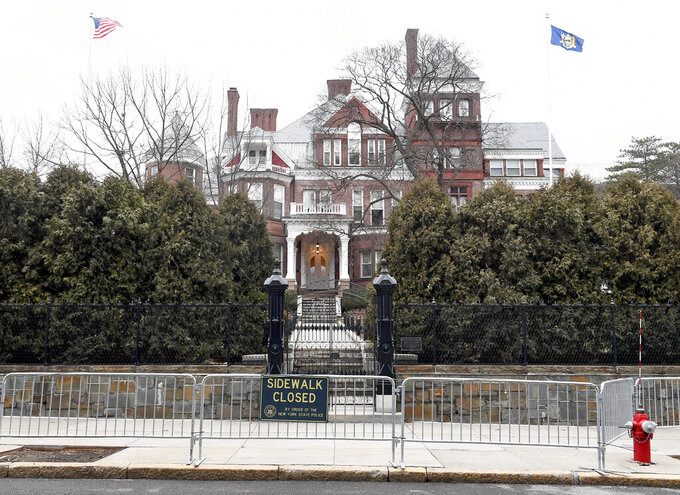 FILE - This Sunday Jan. 17, 2021, file photo shows the New York state Executive Mansion surrounded with security fencing in Albany, N.Y. A sixth woman has come forward alleging that Gov. Andrew Cuomo inappropriately touched her late last year, during an encounter at the mansion. (AP Photo/Hans Pennink, File)
