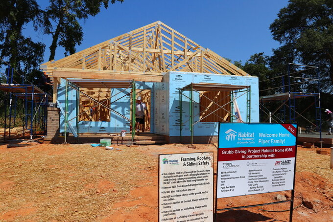 In this photo provided by Habitat for Humanity of Greenville County, a home is constructed by Habitat for Humanity on Sept. 12, 2019, in Greenville, S.C. Reeling from massive cutbacks in volunteers during the COVID-19 pandemic, and grappling with high construction costs, Habitat for Humanity affiliates would be the first to admit they're struggling. (Habitat for Humanity of Greenville County via AP)