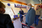 FILE - In this Thursday, Oct. 15, 2020 file photo, Slippery Rock, Pa., Republican Mayor Jondavid Longo, center, greets Donald Trump supporters Dale Filstrup, left, and her husband, Al, second right, of Pittsburgh, at the Butler County Republican Committee office in Slippery Rock, Pa. Trump won Butler County handily in November, evidence of his campaign to supercharge turnout in rural, conservative places as he cedes ground in the cities and suburbs. (AP Photo/Gene J. Puskar)