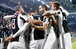 Juventus' Gonzalo Higuain, left, celebrates with teammates after scoring during the Champions League, round of 16, first-leg soccer match between Juventus and Tottenham Hotspurs, at the Allianz Stadium in Turin, Italy, Tuesday, Feb. 13, 2018. (AP Photo/Antonio Calanni)