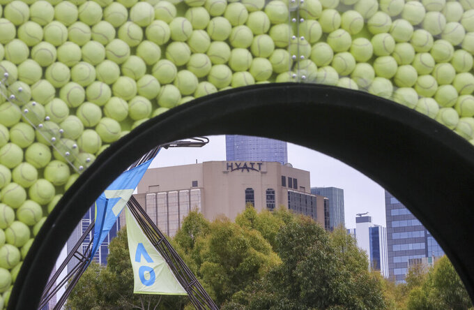 The Grand Hyatt hotel seen from Melbourne Park, venue for the Australian Open tennis championships in Melbourne, Australia, Thursday, Feb. 4, 2021. All competition at six Australian Open tuneup events scheduled for Thursday was called off after a worker at one of the tournaments' Melbourne quarantine hotels tested positive for COVID-19.(AP Photo/Hamish Blair)