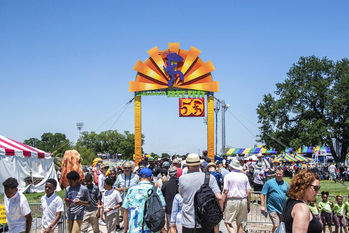 Festival goers attend the New Orleans Jazz and Heritage Festival on Friday, April 26, 2019, in New Orleans. (Photo by Amy Harris/Invision/AP)