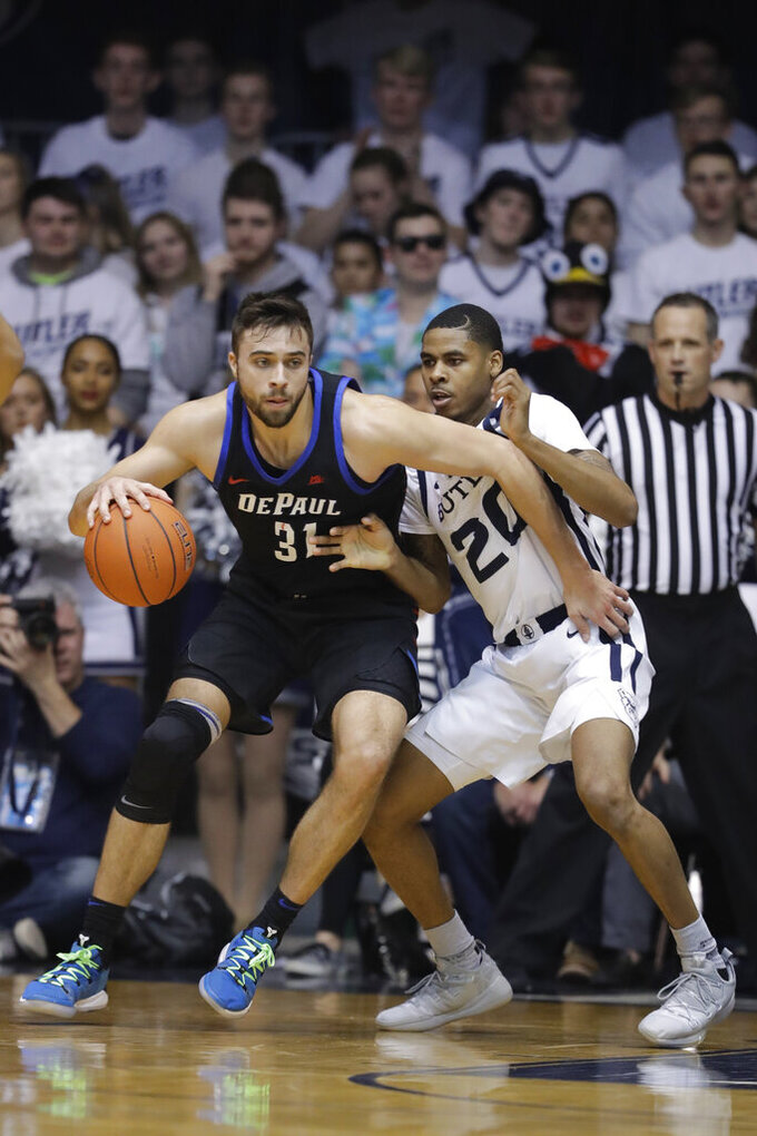 DePaul's Max Strus (31) is defended by Butler's Henry Baddley (20) during the first half of an NCAA college basketball game, Saturday, Feb. 16, 2019, in Indianapolis. (AP Photo/Darron Cummings)