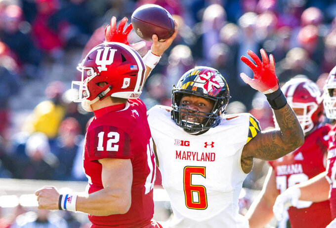 Maryland defensive lineman Jesse Aniebonam (6) closes in on Indiana quarterback Peyton Ramsey (12) as he throws a pass during the second half of an NCAA college football game Saturday, Nov. 10, 2018, in Bloomington, Ind. Indiana won 34-32. (AP Photo/Doug McSchooler)