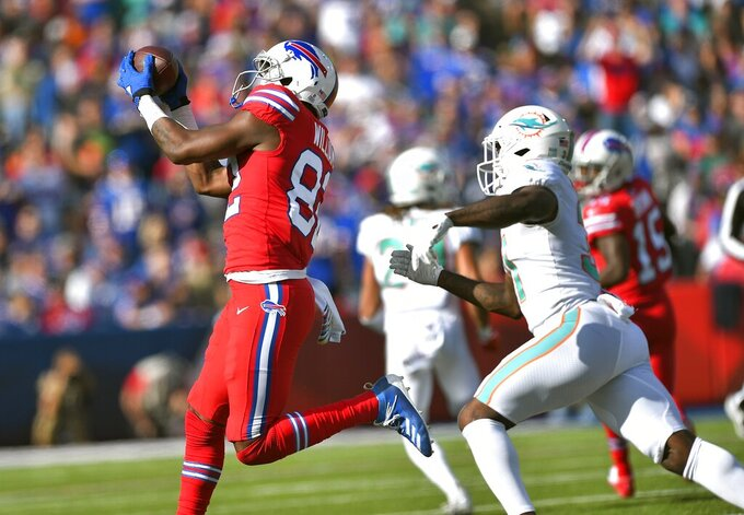 Buffalo Bills wide receiver Duke Williams, left, catches a pass in front of Miami Dolphins defensive back Ken Webster in the second half of an NFL football game, Sunday, Oct. 20, 2019, in Orchard Park, N.Y. (AP Photo/Adrian Kraus)