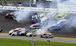 Cars crash, including Alex Bowman (88), Kyle Busch (18), Erik Jones (20), Darrell Wallace Jr. (43), Chase Elliott (9) and Austin Dillon (3) coming out of turn 1 during the NASCAR Cup Series auto race at Daytona International Speedway, Sunday, July 7, 2019, in Daytona Beach, Fla. Both drivers were able to continue with the race. (AP Photo/David Graham)
