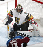 Vegas Golden Knights goaltender Malcolm Subban defends on a shot attempt by Colorado Avalanche center Alexander Kerfoot during the first period of an NHL hockey game Wednesday, March 27, 2019, in Denver. (AP Photo/David Zalubowski)