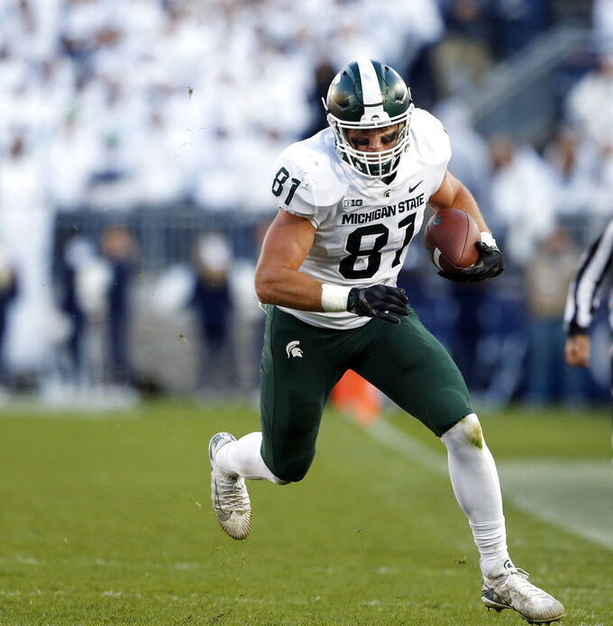 Michigan State's Matt Sokol (81) takes off after a catch against Penn State during the second half of an NCAA college football game in State College, Pa., Saturday, Oct. 13, 2018. (AP Photo/Chris Knight)