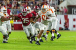 Tennessee running back Tim Jordan (9) breaks loose against Alabama during the first half of an NCAA college football game, Saturday, Oct. 19, 2019, in Tuscaloosa, Ala. (AP Photo/Vasha Hunt)