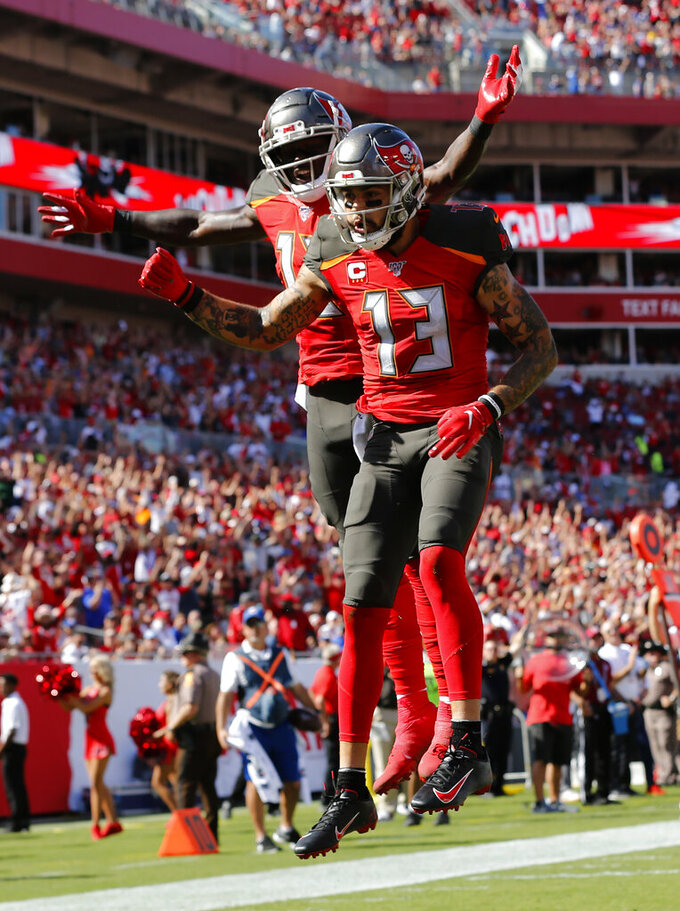 Tampa Bay Buccaneers wide receiver Mike Evans (13) celebrates his touchdown against the New York Giants with wide receiver Chris Godwin (12) during the first half of an NFL football game Sunday, Sept. 22, 2019, in Tampa, Fla. (AP Photo/Mark LoMoglio)