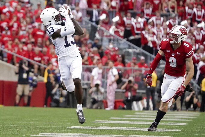 Penn State's KeAndre Lambert-Smith catches a long pass in front of Wisconsin's Scott Nelson during the second half of an NCAA college football game Saturday, Sept. 4, 2021, in Madison, Wis. Penn State won 16-10. (AP Photo/Morry Gash)