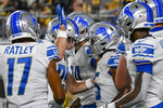 Detroit Lions running back Godwin Idwebuike, center right, is congratulated by teammates after scoring a touchdown against the Pittsburgh Steelers during the second half of an NFL preseason football game Saturday, Aug. 21, 2021, in Pittsburgh. (AP Photo/Don Wright)