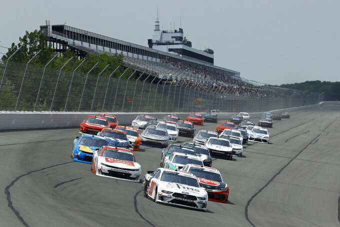 Cole Custer leads the field into Turn One at the start the NASCAR Xfinity Series auto race at Pocono Raceway, Saturday, June 1, 2019, in Long Pond, Pa. (AP Photo/Matt Slocum)