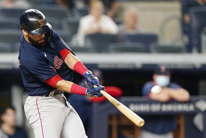 Boston Red Sox second baseman Marwin Gonzalez hits a game-tying, two-run, home run during the seventh inning of a baseball game against the New York Yankees, Sunday, June 6, 2021, at Yankee Stadium in New York. (AP Photo/Kathy Willens)
